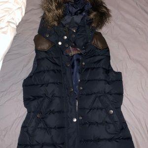 Navy blue vest with detachable faux fur hood